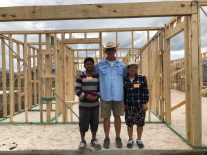 troy jessee at house build with a family